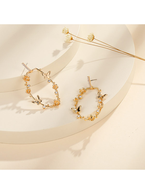 The new butterfly copper casting inlaid zircon personality a